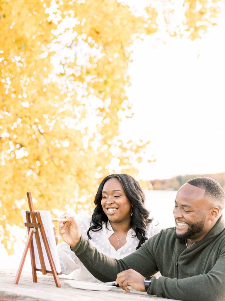 fall engagement session couple painting date at Seven Lakes State Park