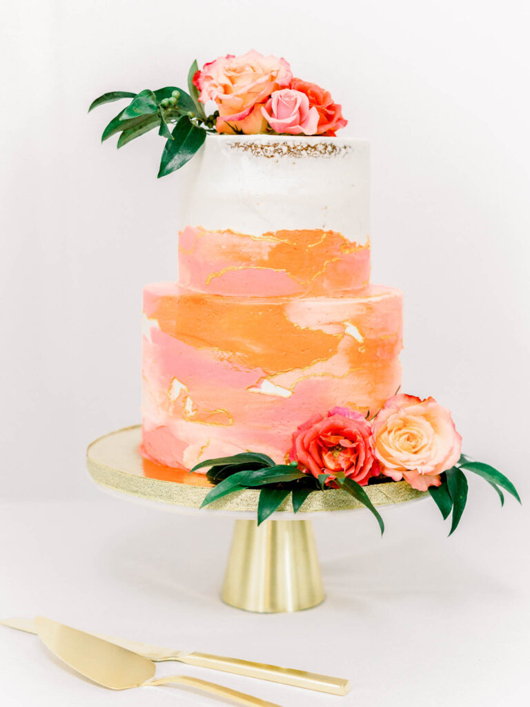 Coral pink painted buttercream wedding cake featuring garden roses by Chinling Photography