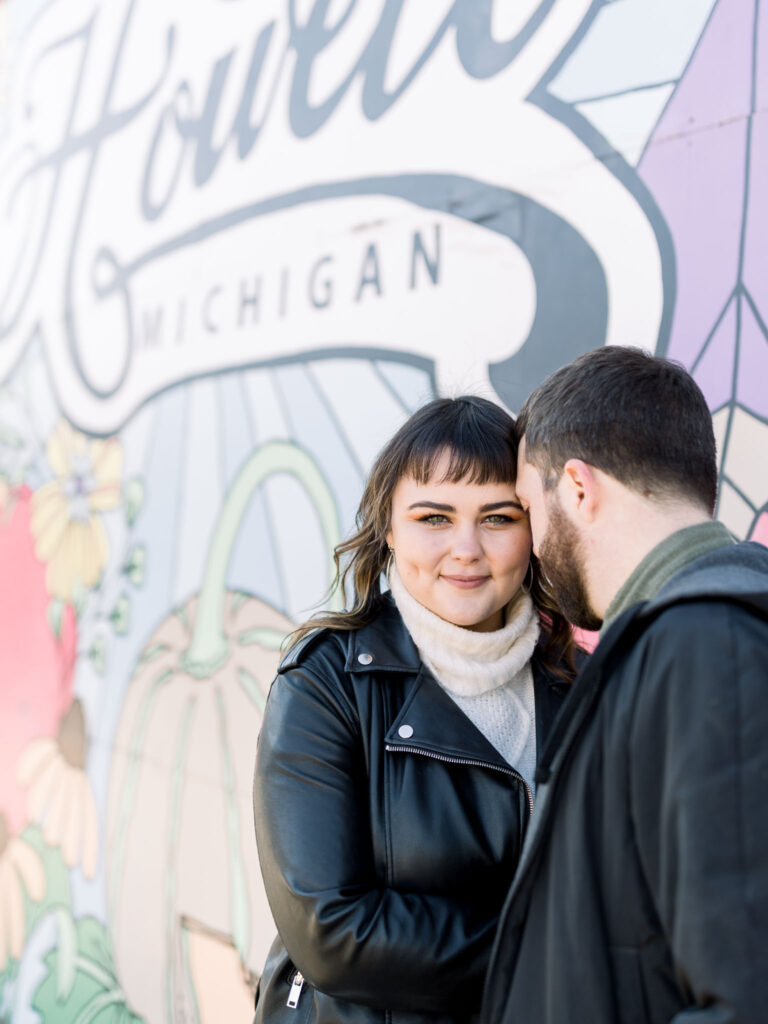 Downtown Howell Engagement Session in front of Mural Wall