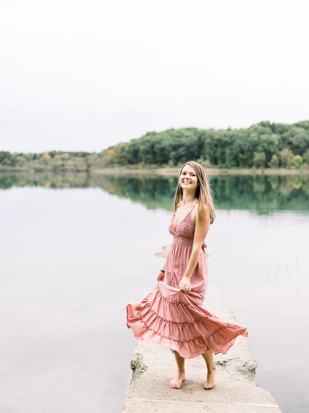 bride to be twirling blush long dress fenton engagement session seven lakes state park