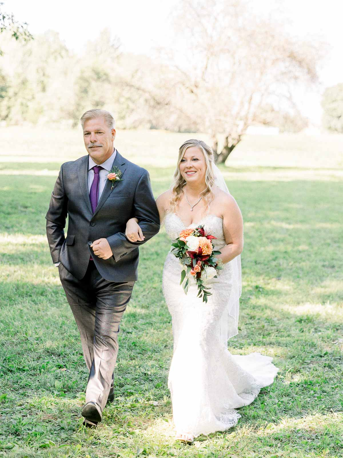 bride walking down the aisle with father outdoor Michigan wedding by Chinling Photography
