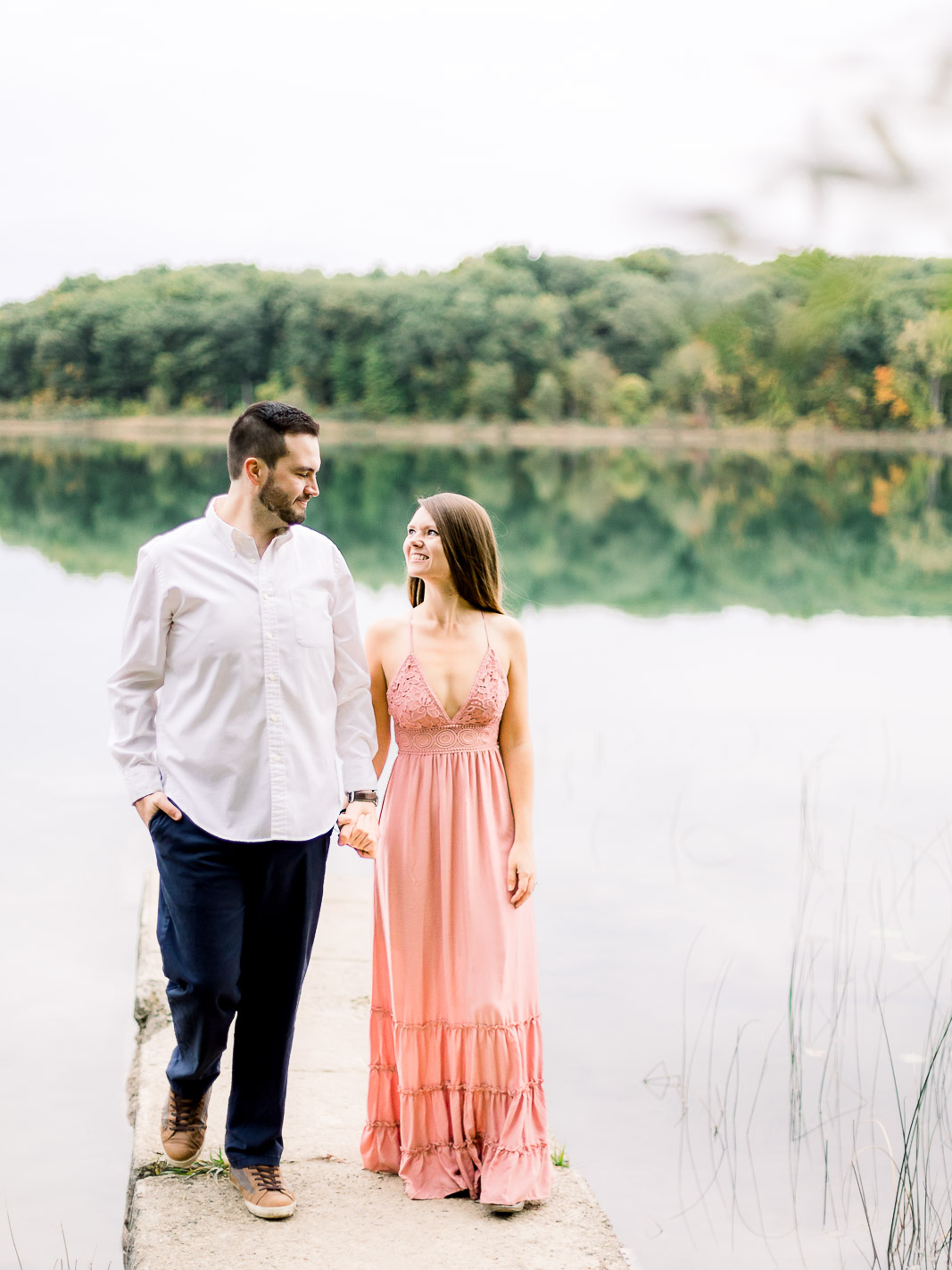 couple holding hands and walking engagement session seven lakes state park